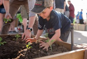 Grow-A-Row-child-planting